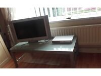 Glass table with tv and dvd player