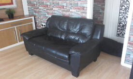 two leather two seat sofas