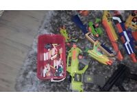 Multiple toy guns with bullets.