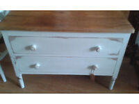 a shabby chic chest of drawers painted and distressed with stripped top