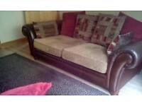 Leather sofa dfs. Perez with good. Quality. Red and beige.cushions 76inch long no pets or no. Pets