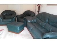 Leather three peice suite with matching pouffe in dark green with oak trim
