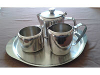 Stainless steel tea set with tea pot, milk jug, sugar bowl and tray, in very good condition