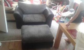 Black and grey sofa with foot stool