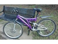 MOUNTAIN BIKE IN GOOD CONDITION AT CITY CENTRE.