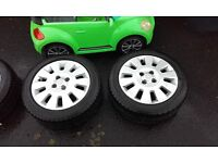 4x100 15 inch Vauxhall alloys 2 new tyres and two good tyres couple of marks on them £100 no offers
