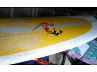 Raw 8 foot long surfboard with nose guard excellent condition