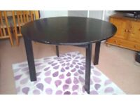 Round black ash round dining table and two chairs
