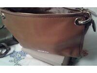 Michael kors light tan leather handbag.
