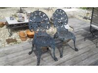 PAIR OF MATCHING CAST IRON ( NOT ALLOY ) HEAVY GARDEN PATIO CHAIRS VERY PRETTY AND SOUND CONDITION