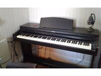 Roland digital piano in very good condition ,cost over a grand a few years ago all the extras.