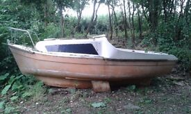 Free Boat needs TLC. with masts, sail, rudder, no trailer