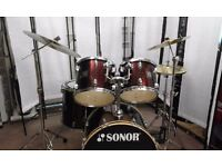 Retired drum teacher has a Sonor drum kit with Paiste PST3 cymbals for sale.