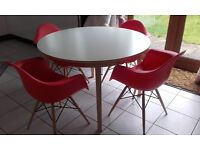Red modern chairsand extending table