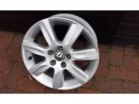 "VW 15"" 7-spoke alloy wheel."