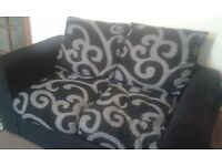 2 Seater Black and Grey Sofa. Good Condition. (Also Selling 3 Seater in Same Design)