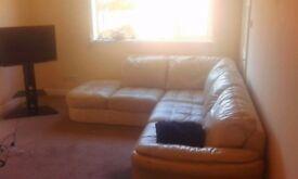 L shaped cream colour leather sofa