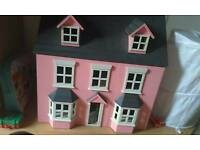 Dolls house with Sylvanian Families furniture and accessories