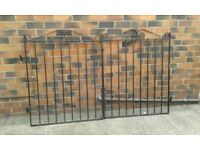 Wrought iron gates with drop bars to secure