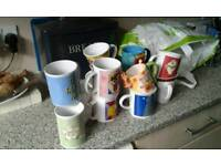 12 assorted mugs and 3 cups and saucers