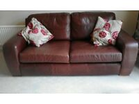 Brown leather sofa and matching stool/table