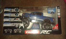 Carrera Remote control 4 x 4 truck NEW IN BOX (full suspension and working lights)