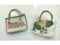 Hand made bags from Thailand. These bags are from material and are decorated in traditional design.