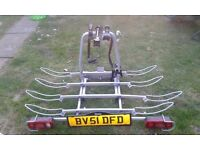 THIS IS A TOWSAFE TOW-BAR MOUNTED 4 BIKE RACK, ONLY USED A COUPLE OF TIMES