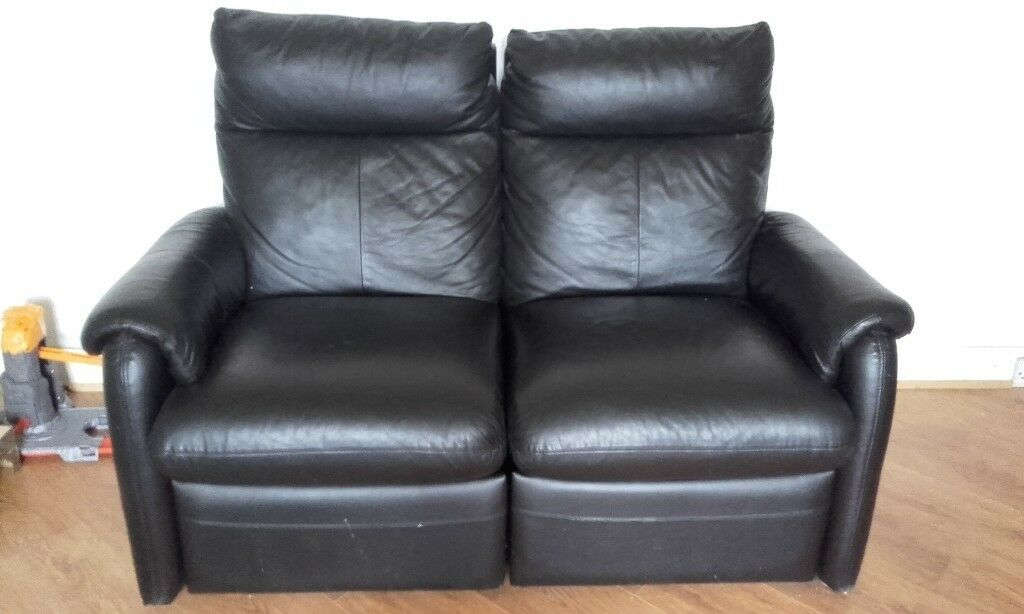 3 and 2 seater black leather sofas, 4 seats recline in good condition.