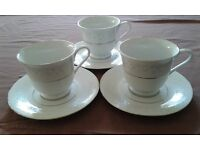 Vintage bone china tea set, 3 cups and saucers, white with silver and blue flowers