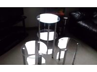 Three glass side tables