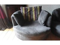Swivel Arm Chairs in brown cord fabric - pair of DFS large circular swivel arm chairs.