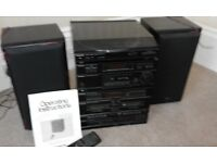 Panasonic stereo system with turntable radio CD and twin tape deck. Complete with two speakers.