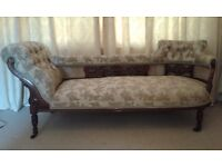 Victorian Chaise Longue upholstered with buttoned ends and carved woodwork