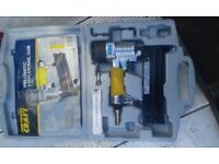 pneumatic stapler/nail gun in box unused