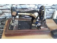 Vintage antique singer sewing machine with wooden case