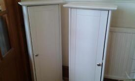 Two Cream Corner Cabinets