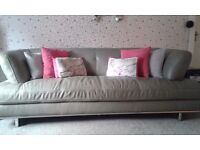 Modern, stylish leather 3 seater sofa and arm chair in very good condition.
