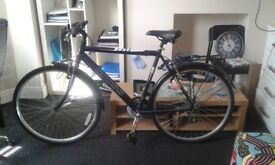New Hybrid bicycle for sale in perfect condition.