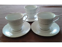 Vintage bone china tea set, 3 cups and saucers, white with blue and silver.