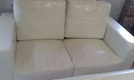 Cream leather two seater sofas x 2