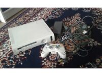 X box 360 console and one controller