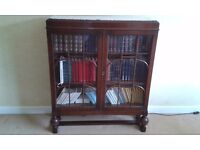 Oak glass fronted bookcase.