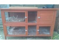 Rabbit hutch plus litter trays bottles some food and big indoor travel hutch