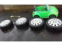 4x100 15 inch Vauxhall alloys 2 new tyres and two good tyres couple of marks on them