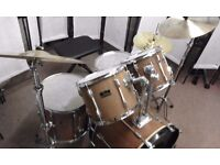 Retired drum teacher has a Pearl Export drum kit with Paiste cymbals for sale.
