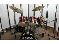 Retired drum teacher has a Tama Rockstar 6 piece Fusion drum kit with Paiste PST3 cymbals for sale.