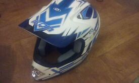Youth large helmet in mint condition plus gloves and knee protectors and bag for helmet to go in.