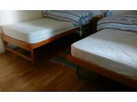 "Two ""Easy-store"" Single Beds with New Mattresses"