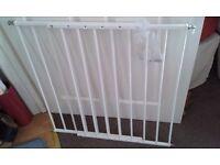 White metal extending stair gate.